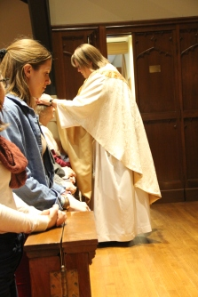 Mother Becca blessing ECM students after her ordination to the priesthood